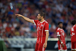 MUNICH, GERMANY - Tuesday, August 1, 2017: FC Bayern Munich's Javi Martinez throws a plastic bottle of water during the Audi Cup 2017 match between FC Bayern Munich and Liverpool FC at the Allianz Arena. (Pic by David Rawcliffe/Propaganda)