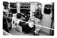 Commuters on the Tokyo subway, Japan. 1987.