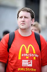 © Licensed to London News Pictures. 01/05/2018. LONDON, UK.  A demonstrator, wearing a McStrike T shirt, takes part in the annual May Day Rally on International Workers' Day, having marched through central London to a rally in Trafalgar Square.  Photo credit: Stephen Chung/LNP