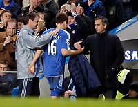 Photo: Ed Godden/Sportsbeat Images.<br />Chelsea v Wigan Athletic. The Barclays Premiership. 13/01/2007. Chelsea's Arjen Robben is greeted by Manager Jose Mourinho as he is substituted.