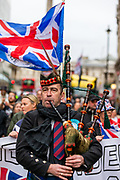 Dozens of Brexit supporters march through Trafalgar Square to celebrate Britain's departure from the EU in London, Friday, Jan. 31, 2020. Britain officially leaves the European Union on Friday after a debilitating political period that has bitterly divided the nation since the 2016 Brexit referendum. (Photo/Vudi Xhymshiti)