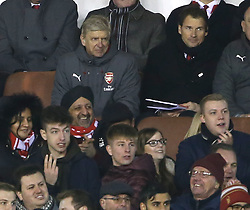 07 January 2018 FA Cup 3rd round Nottingham - Nottingham Forest v Arsenal - Arsenal manager Arsene Wenger giving a wry smile in the stands as the Forest fans around him celebrate the award of a second penalty.<br /> (photo by Mark Leech)