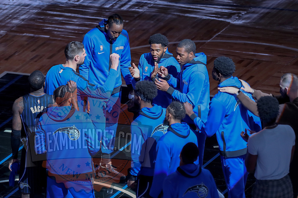 ORLANDO, FL - MARCH 03: Orlando Magic players huddle up against the Atlanta Hawks at Amway Center on March 3, 2021 in Orlando, Florida. NOTE TO USER: User expressly acknowledges and agrees that, by downloading and or using this photograph, User is consenting to the terms and conditions of the Getty Images License Agreement. (Photo by Alex Menendez/Getty Images)*** Local Caption ***