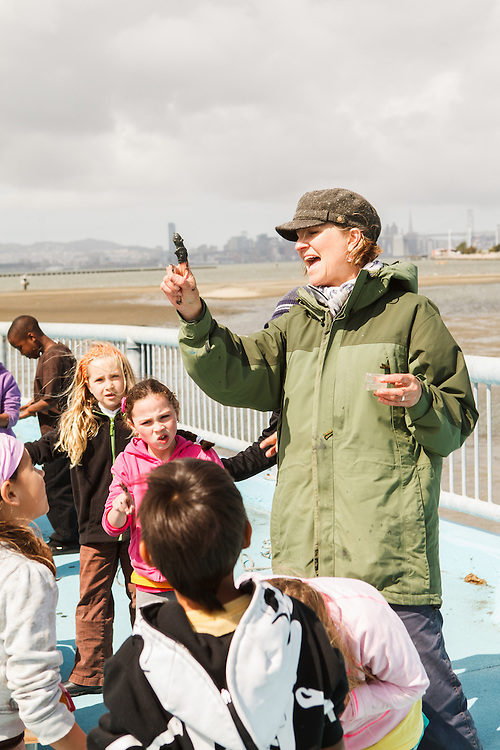 Second grade students from Melrose Leadership Academy, an OUSD public school, learn about the San Francisco Bay environment at the Middle Harbor Shoreline Park. The Port of Oakland owns and operates the park that was previously the Oakland Naval Supply Depot during World War II.