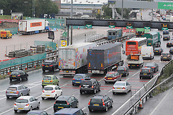 © Licensed to London News Pictures. 25/08/2014. Dartford.  The lorry in a lay-by at Dartford Crossing (left). 13 suspected illegal immigrants have been found in the back of a lorry at Darford River Crosing this morning (25.08.2014) about 11.30 am. One person has been taken to hospital while the immigration service investigate.<br /> (Byline:Grant Falvey/LNP)
