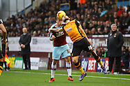 Scott Arfield of Burnley and Robert Snodgrass of Hull City challenge for the ball. Skybet football league Championship match, Burnley v Hull city at Turf Moor in Burnley ,Lancs on Saturday 6th February 2016.<br /> pic by Chris Stading, Andrew Orchard sports photography.