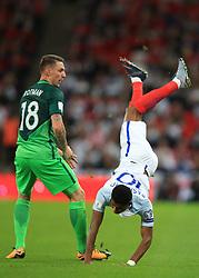 5 October 2017 -  2018 FIFA World Cup Qualifying (Group F) - England v Slovenia - Marcus Rashford of England collides with Rajko Rotman of Slovenia - Photo: Marc Atkins/Offside