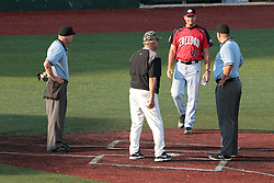 06 June 2014:  Plate Umpire: Dave Logan Field Umpire #1: Drew Ashcroft, Brooks Carey and Field Manager Fran Riordan during a Frontier League Baseball game between the Frontier Freedom and the Normal CornBelters at Corn Crib Stadium on the campus of Heartland Community College in Normal Illinois