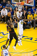 Golden State Warriors forward Draymond Green (23) attempts to block a shot by Cleveland Cavaliers forward LeBron James (23) during Game 1 of the NBA Finals at Oracle Arena in Oakland, Calif., on May 31, 2018. (Stan Olszewski/Special to S.F. Examiner)