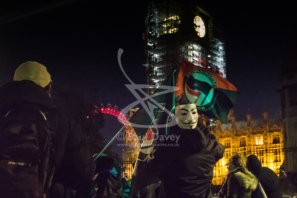 London, November 05 2017. Anti-capitalists gather in Trafalgar Square, London for the annual 'Million Mask March' which happens on November 5th every year, with many of the protesters donning 'V' For Vendetta Guy Fawkes masks. Past marches have turned violent with police horses shot by fireworks and police vehicles burned. PICTURED: Protesters march past Parliament . © Paul Davey