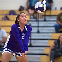 090914     Cayla Nimmo<br /> <br /> Miyamura Patriot Alaiah Nelson (22) prepares to set the ball during the game against Laguna-Acoma Lady Hawks Tuesday night at Miyamura High School.