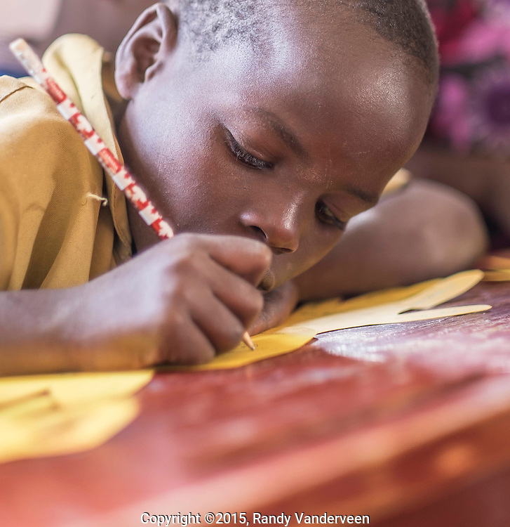 Photo Randy Vanderveen<br /> Kinigi, Musanze District, Rwanda<br /> 2015-05-23<br /> Children participate in a Children of Hope (a support group for children affected by HIV/AIDS through infection or having a parent or sibling infected with the virus) meeting. Teens and young adults are trained as mentors for the younger members of the group. This group is unique in Rwanda as it is geared for children and young people rather than for adults.