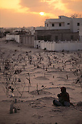 """Graves surround a private """"villa"""" hospital in the north sector of Mogadishu, the war-torn capital of Somalia where 30,000 people were killed between November 1991 and March 1992. March 1992."""