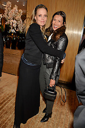 Left to right, BAY GARNETT and HIKARI YOKOYAMA at the Louis Vuitton for Unicef Event #MAKEAPROMISE held at The Apartment, 17-20 New Bond Street, London on 14th January 2016.