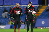 Manchester United Goalkeeper Lee Grant and Manchester United Goalkeeper David De Gea in warm up during the The FA Cup 5th round match between Chelsea and Manchester United at Stamford Bridge, London, England on 18 February 2019.
