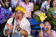03 JANUARY 2014 - BANGKOK, THAILAND:  An anti-government protestor in Bangkok cheers for Suthep Thaugsuban. Thousands of Thai anti-government protestors came to Democracy Monument in Bangkok Friday night to hear Suthep Thaugsuban, the leader of the protests, announce his plans to shut down the city of Bangkok. Suthep said his protestors would occupy 20 major intersections in the commercial sections of Bangkok for up to three weeks or until the caretaker government of Yingluck Shinawatra resigns.    PHOTO BY JACK KURTZ