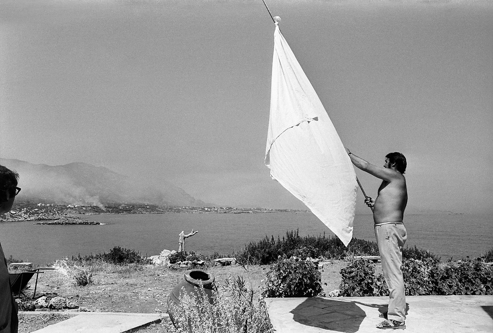 Cyprus War 20 July-18 August 1974. Turkish invasion of Cyprus code-name by Turkey, Operation Attila. British tourist John Rogers waves a white flag to the Turkish invading forces coming ashore on the island of Cyprus near Kyrenia July 1974. Photo by Terry Fincher.