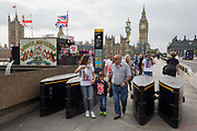 Families pass through the new anti-vehicle security barriers located on the southern Lambeth end of Westminster Bridge, on 6th September 2017, in London, England.