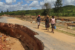 March 22, 2019 - Chimanimani, Zimbabwe - Women walk on the side of a damaged road. Five days after tropical cyclone Idai cut a swathe through Mozambique, Zimbabwe and Malawi, the confirmed death toll stood at more than 300 and hundreds of thousands of lives were at risk, officials said. (Credit Image: © Tafadzwa Ufumeli/ZUMA Wire)
