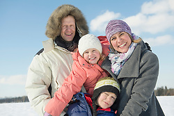 Portrait of family in winter, smiling, Bavaria, Germany