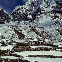 Cholatse peak rises above Pangka village in the Gokyo Valley in the Khumbu region of Nepal. 1979