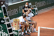 Jo-Wilfried Tsonga of France (left), his coach Thierry Ascione and his fitness coach during practice ahead of the French Open 2021, a Grand Slam tennis tournament at Roland-Garros stadium on May 29, 2021 in Paris, France - Photo Jean Catuffe / ProSportsImages / DPPI