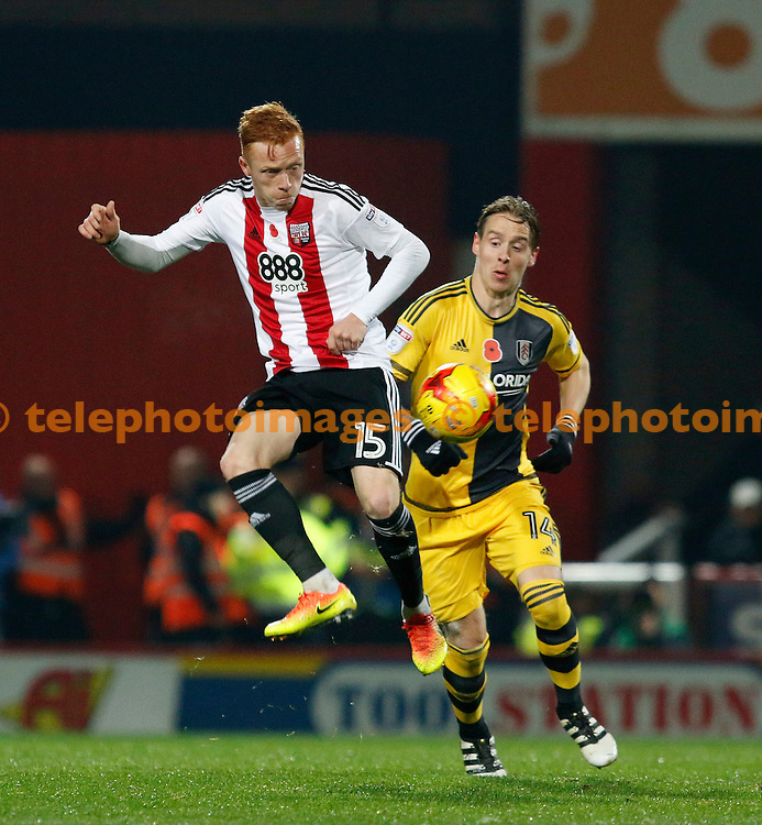 Brentford's Ryan Woods lays off the ball during the Sky Bet Championship match between Brentford and Fulham at Griffin Park in London. November 4, 2016.<br /> Carlton Myrie / Telephoto Images<br /> +44 7967 642437