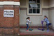 Children and their scooters outside their local polling station on the morning of the UK 2017 general elections outside St. Saviours Parish Hall in Herne Hill, Lambeth, on 8th June 2017, in London, England.