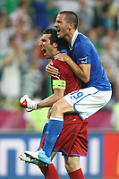 Football - European Championships 2012 - Republic of Ireland vs. Italy<br /> Gianluigi Buffon and Leonardo Bonucci of Italy celebrate progressing through to the next round at the Municipal Stadium, Poznan