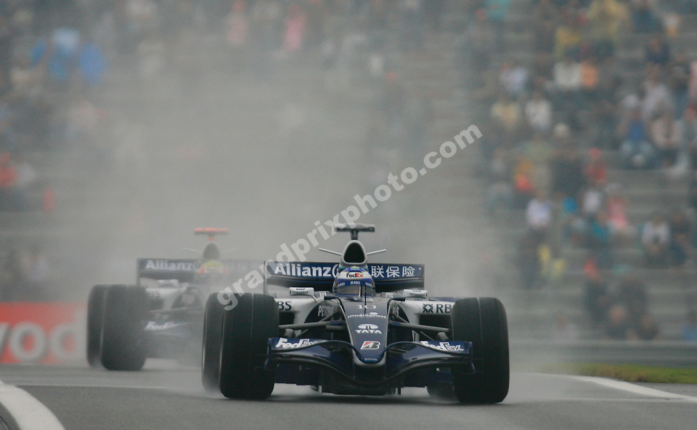 Nico Rosberg leads Williams-Cosworth team-mate Mark Webber during the wet qualifying session for the 2006 Chinese Grand Prix in Shanghai. Photo: Grand Prix Photo