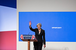 © Licensed to London News Pictures . 03/10/2018. Birmingham, UK. Prime Minister THERESA MAY enters the conference hall dancing to Dancing Queen by ABBA , as she steps up to deliver the Leader's Speech . Day 4 of the Conservative Party conference at the ICC in Birmingham . Photo credit: Joel Goodman/LNP