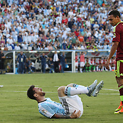 FOXBOROUGH, MASSACHUSETTS - JUNE 18:  Lionel Messi #10 of Argentina feels the pain after a challenge from Arquimedes Figuera #5 of Venezuela during the Argentina Vs Venezuela Quarterfinal match of the Copa America Centenario USA 2016 Tournament at Gillette Stadium on June 18, 2016 in Foxborough, Massachusetts. (Photo by Tim Clayton/Corbis via Getty Images)