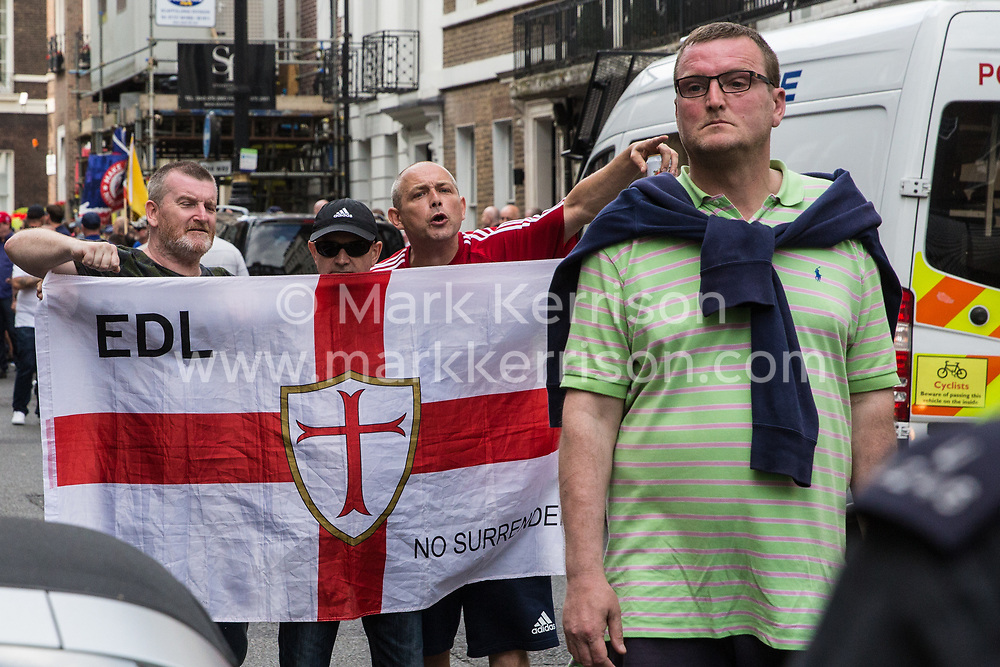 London, UK. 10th June, 2018. Supporters of the English Defence League hold a flag as they protest against the pro-Palestinian Al Quds Day march through central London organised by the Islamic Human Rights Commission. An international event, it began in Iran in 1979. Quds is the Arabic name for Jerusalem.