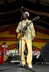 30 April 2006. New Orleans, Louisiana. Jazzfest . <br /> The first New Orleans Jazz and Heritage festival following the disaster of Hurricane Katrina. <br /> Legendary local singer and guitar player Walter 'Wolfman' Washington on the Congo Square Louisiana Rebirth Stage.<br /> Photo ©Charlie Varley/varleypix.com<br /> All rights reserved.