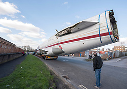 © Licensed to London News Pictures; 27/02/2021; Bristol, UK. A Boeing 727 fuselage arrives at Pytch in Brislington having been transported by road from Cotswold Airport to Bristol via the M5 and M4. Pytch owner Johnny Palmer will use the plane fuselage for an eco-friendly office and event space for the business. The plane as used by Japan Airlines before going into private ownership in the 1970s, sold for £50million when new. Mr Palmer got it for less than £100,000 because it does not have an engine or wings. Photo credit: Simon Chapman/LNP.