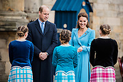 The Duke and Duchess of Cambridge attended a Beating Retreat by the Massed Pipes and Drums of the Combined Cadet Force in Scotland.
