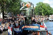 Canal Parade 2013 in de Amsterdamse grachten. De Canal Parade is het hoogtepunt van de Gay Pride, een feestweek met voornamelijk homo's, bi's, lesbiennes en transgenders.<br /> <br /> Canal Parade 2013 in the canals of Amsterdam. The Canal Parade is the highlight of the Gay Pride, a festival week with mostly gay, bisexual, lesbian and transgender people.<br /> <br /> Op de foto / On the photo: <br /> <br />  Defensieboot tijdens de botenparade / Defence boat during the boat parade