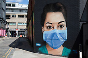 NHS nurse wearing a face mask virus street art in Shoreditch as lockdown continues and people observe the stay at home message in the capital on 12th May 2020 in London, England, United Kingdom. Coronavirus or Covid-19 is a new respiratory illness that has not previously been seen in humans. While much or Europe has been placed into lockdown, the UK government has now announced a slight relaxation of the stringent rules as part of their long term strategy, and in particular social distancing.