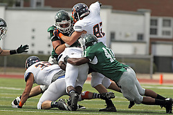 28 September 2013:  Chris Simms stops Shawn Jackson during an NCAA division 3 football game between the Hope College Flying Dutchmen and the Illinois Wesleyan Titans in Tucci Stadium on Wilder Field, Bloomington IL
