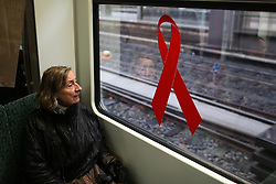 BERLIN, Dec. 1, 2013  A Passenger sits beside a window decorated with a red ribbon for World AIDS Day on a S-Bahn inter-city train in Berlin, Germany, on Dec. 1, 2013. (Xinhua/Zhang Fan) (Credit Image: © Xinhua via ZUMA Wire)