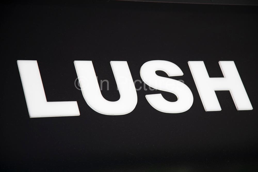Sign for the cosmetics brand LUSH in Birmingham, United Kingdom.