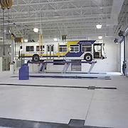 Chula Vista city bus on lift in repair facility.