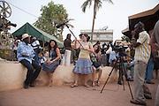 A film crew interview an African film maker during FESPACO in Ouagadougou