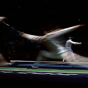 A blur of motion as Artur Akhmatkhuzin, Russia, (left) competes with Jianfei Ma, China, in the Men's Foil Individual event during the Fencing competition at ExCel South Hall during the London 2012 Olympic games. London, UK. 31st July 2012. Photo Tim Clayton