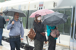 © Licensed to London News Pictures 09/08/2021. <br /> Petts Wood, UK. Monday morning wet weather for London commuters at Petts Wood Train Station in South East London. Photo credit:Grant Falvey/LNP