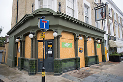 © Licensed to London News Pictures. 04/07/2020. London, UK. The Albert pub in Primrose hill , North London, remains closed and boarded up, despite Pubs, bars, cafes and restaurants being allowed to fully open for the first time since lockdown. Photo credit: Ben Cawthra/LNP