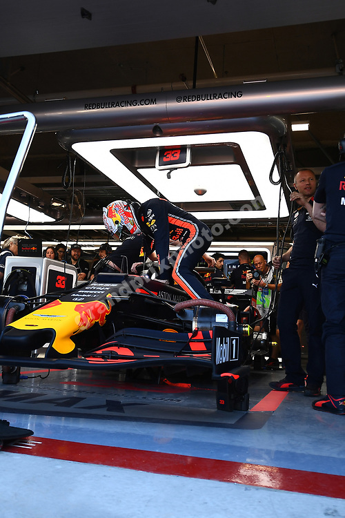 Watched by Ole Schack, Max Verstappen clims into hos Red Bull-Honda before practice for the 2019 Canadian Grand Prix in Montreal. Photo: Grand Prix Photo