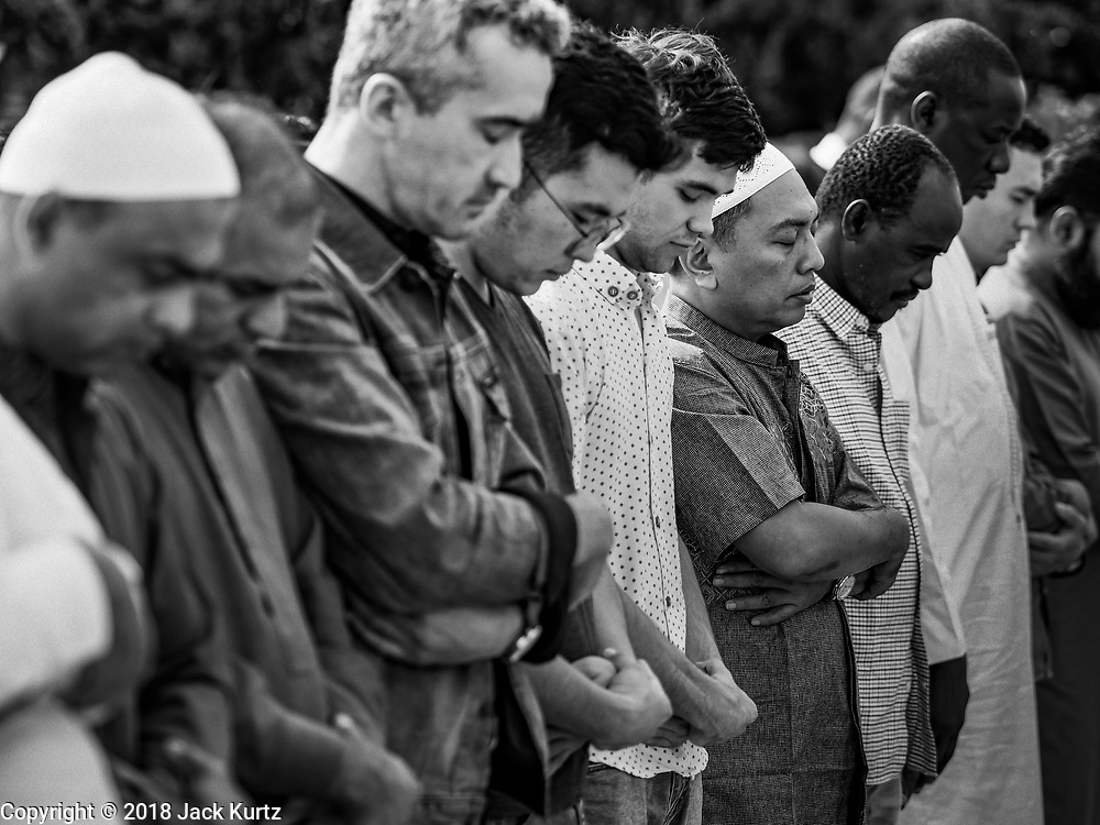 15 JUNE 2018 - SEOUL, SOUTH KOREA: Men pray at Seoul Central Mosque on Eid al Fitr, the Muslim Holy Day that marks the end of the Holy Month of Ramadan. There are fewer than 100,000 Korean Muslims, but there is a large community of Muslim immigrants in South Korea, most in Seoul. Thousands of people attend Eid services at Seoul Central Mosque, the largest mosque in South Korea.    PHOTO BY JACK KURTZ