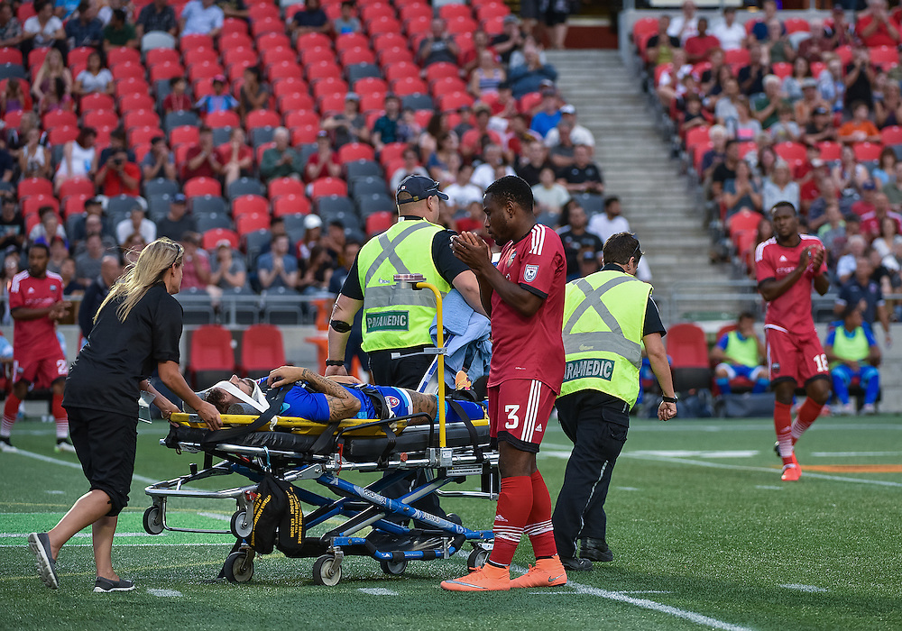 Ottawa Fury FC defender Eddie Edward (#3) applauds as former Fury midfielder Johnny Steele is stretchered off during the NASL match between the Ottawa Fury FC and the Miami FC at TD Place Stadium in Ottawa, ON. Canada on Aug. 24, 2016. The game finishing 0-0.<br /> <br /> PHOTO: Steve Kingsman/Freestyle Photography