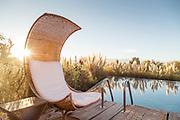 Chair by swimming pool on sunny day at Tierra Atacama Hotel in San Pedro de Atacama, Chile